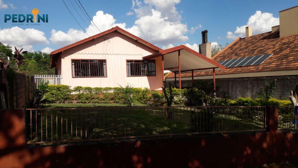 Terreno com Casa no Centro